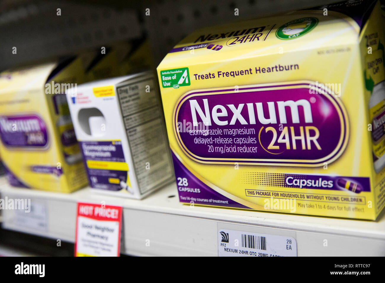 Nexium antacid over-the-counter medicine photographed in a pharmacy. - Stock Image