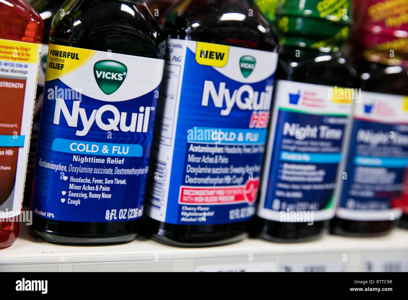 NyQuil and DayQuil over-the-counter cold medicine photographed. - Stock Image