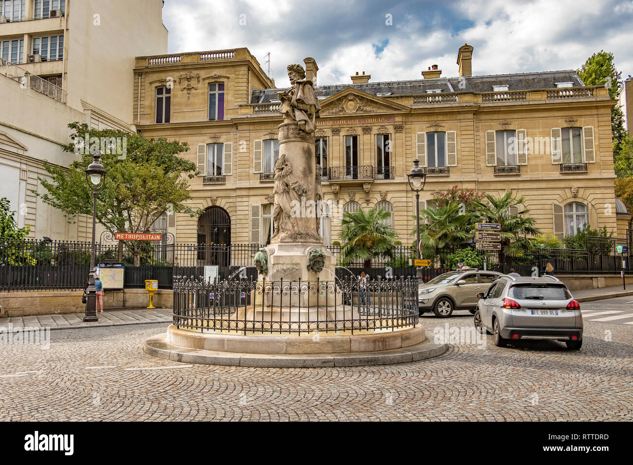 The elegant , circular Place Saint-Georges with a fountain surmounted with the bust of the illustrator Paul Garvani in the centre of the circle,Paris - Stock Image