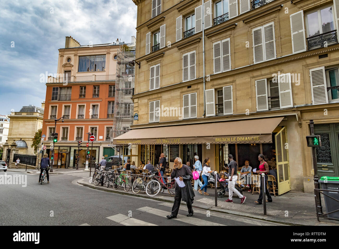 A man crosses the road out the Bo Man cafe and restaurant , Rue Notre-Dame-de-Lorette , Paris,France Stock Photo