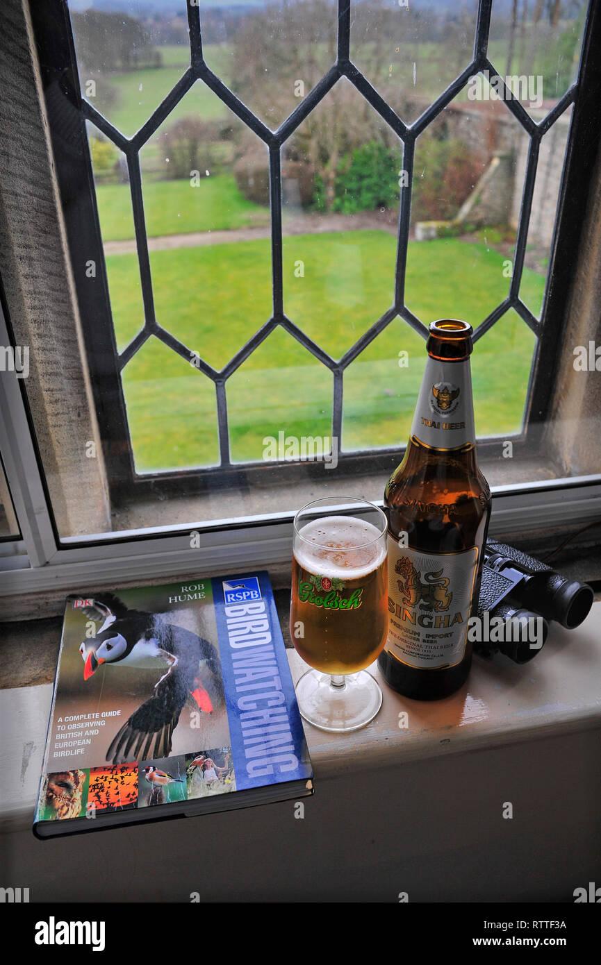 Birdwatching Beer Hobbies - Stock Image