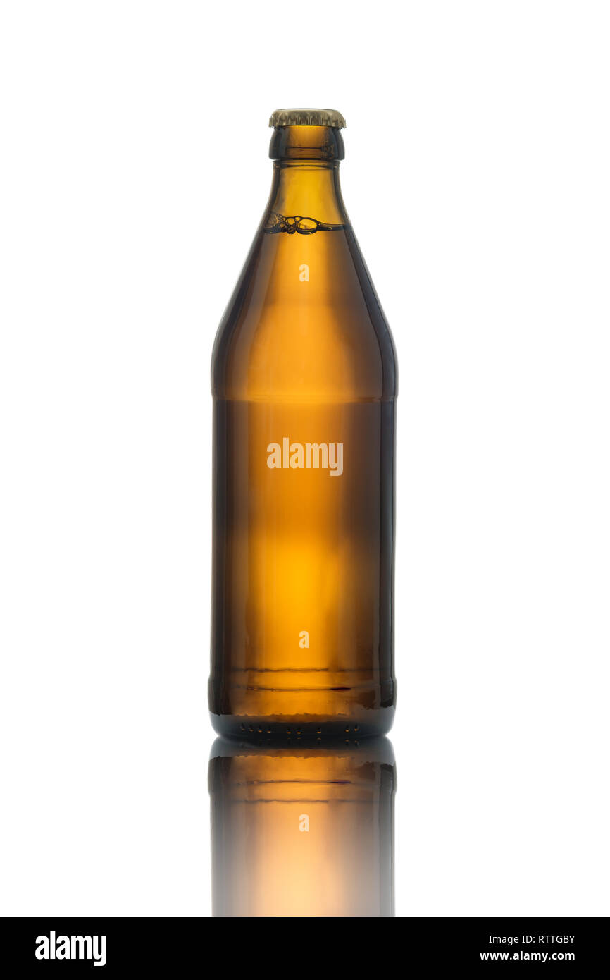 Brown beer bottle in back lit white isolated - Stock Image