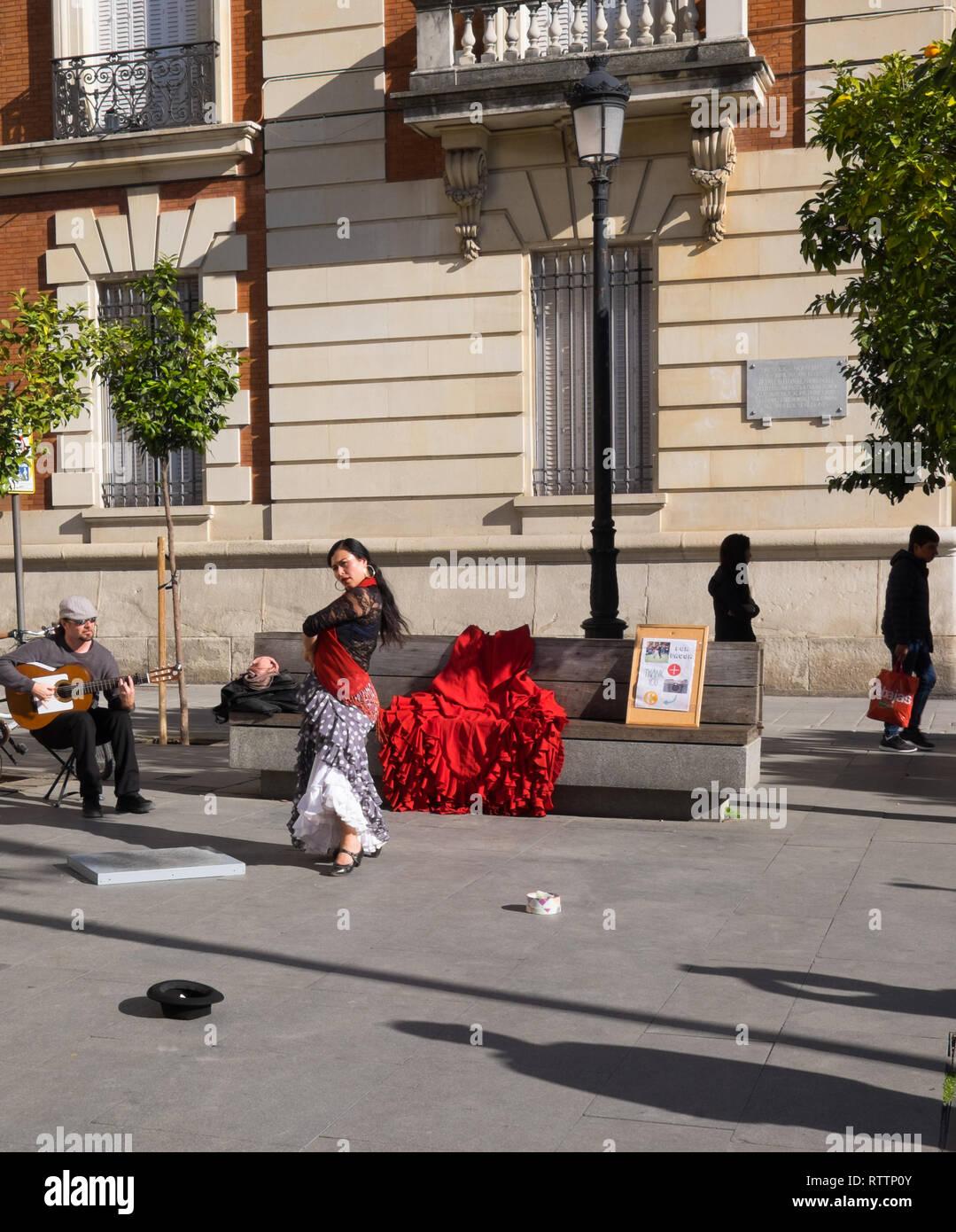 Flamenco dancer & guitarist busking on a Seville street Spain 3.2.19 - Stock Image