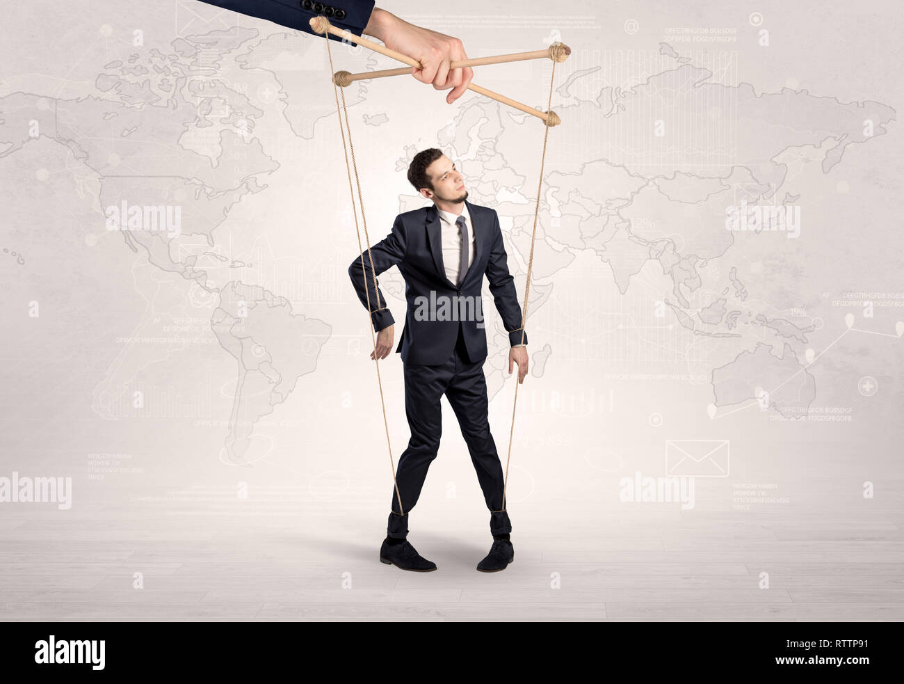 Puppet man with big city great power concept  - Stock Image