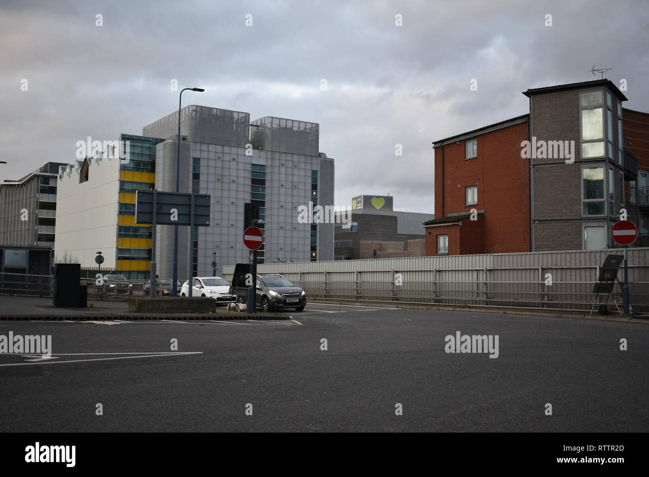 Distant view of Grenfell Tower currently being refurbished and repaired. The view through is from the pedestrian crossing outside Westfield Shops. - Stock Image