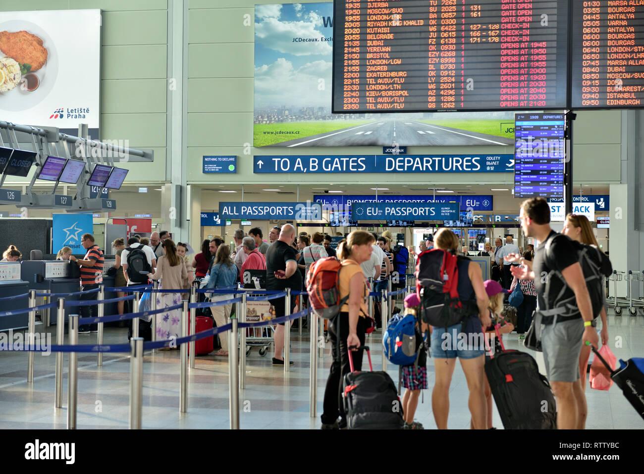 Passengers departures, looking at schedule boards in Vaclav Havel Airport terminal 1,  Prague, Czech Republic - Stock Image