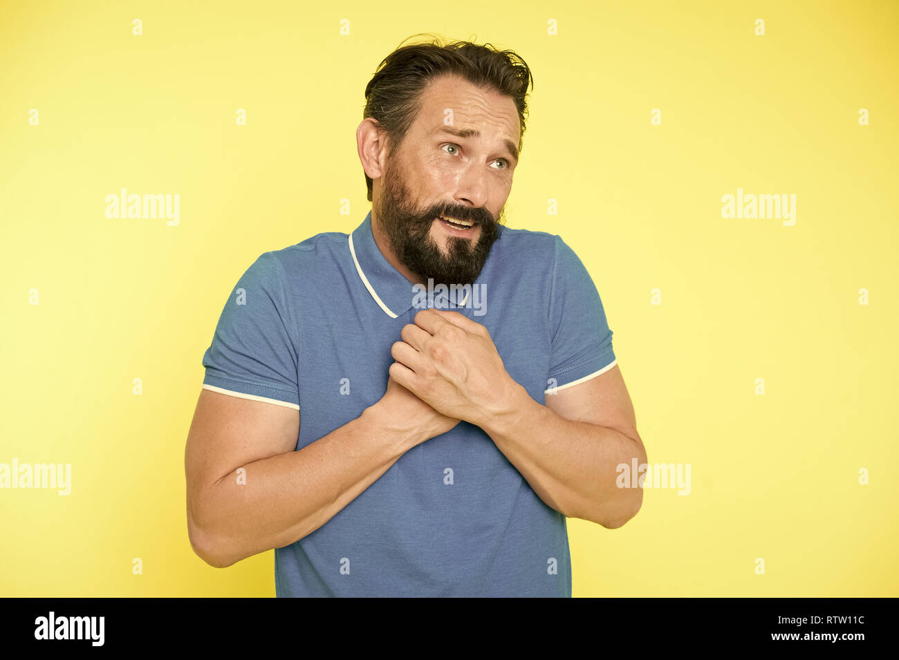 Feel so sorry. Man bearded regretful face, yellow background. Guy bearded sorry gesture. Ask for apologies. Man with beard looks pitiful. Man regret about done and ask to forgive him. Forgive me. - Stock Image