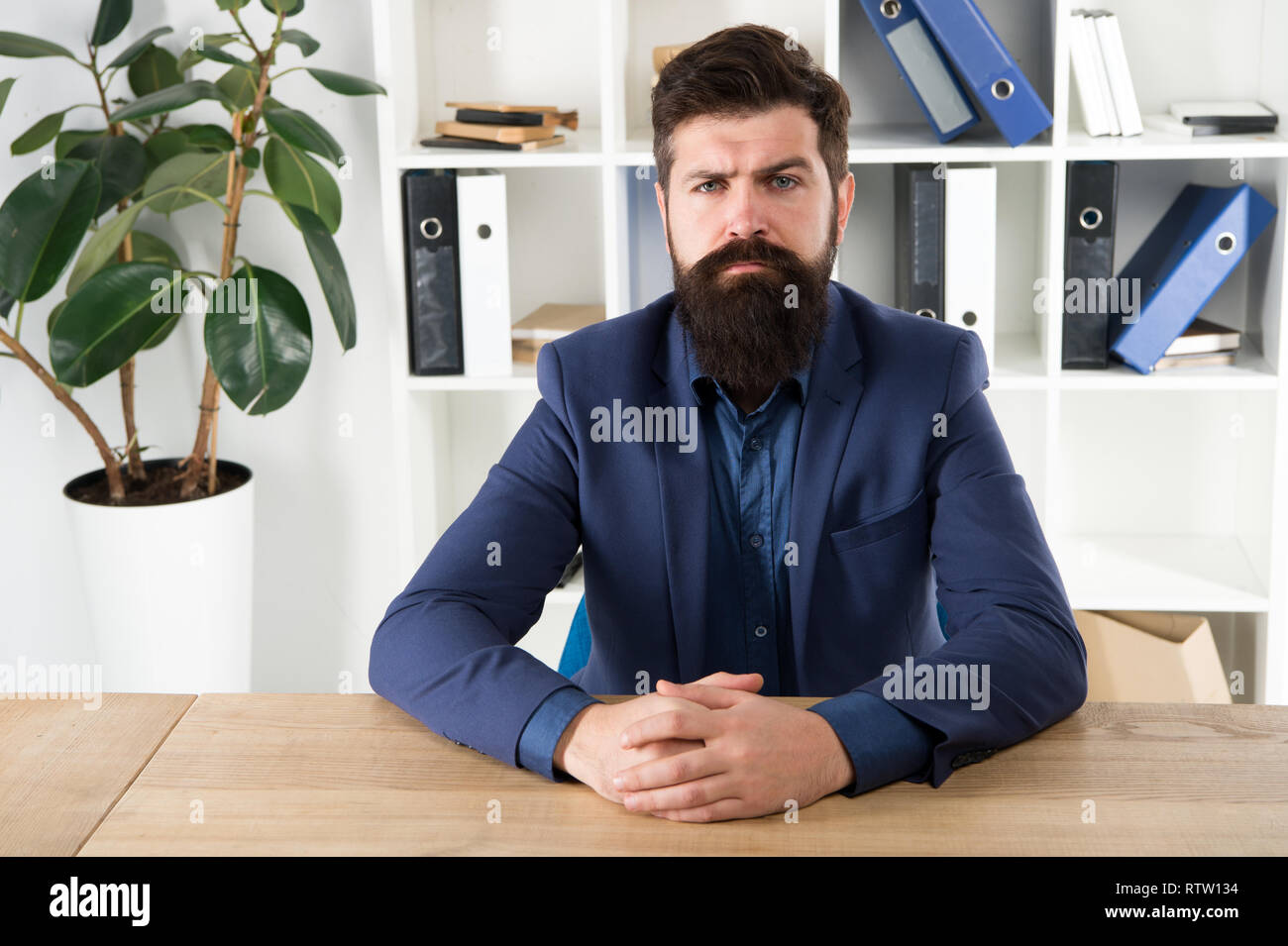 Report and complaint concept. Man bearded hipster boss looking at you with attention. Boss sit in office. Boss receive complaints. Meeting with boss. I am listening. Ready to hear your opinion. - Stock Image