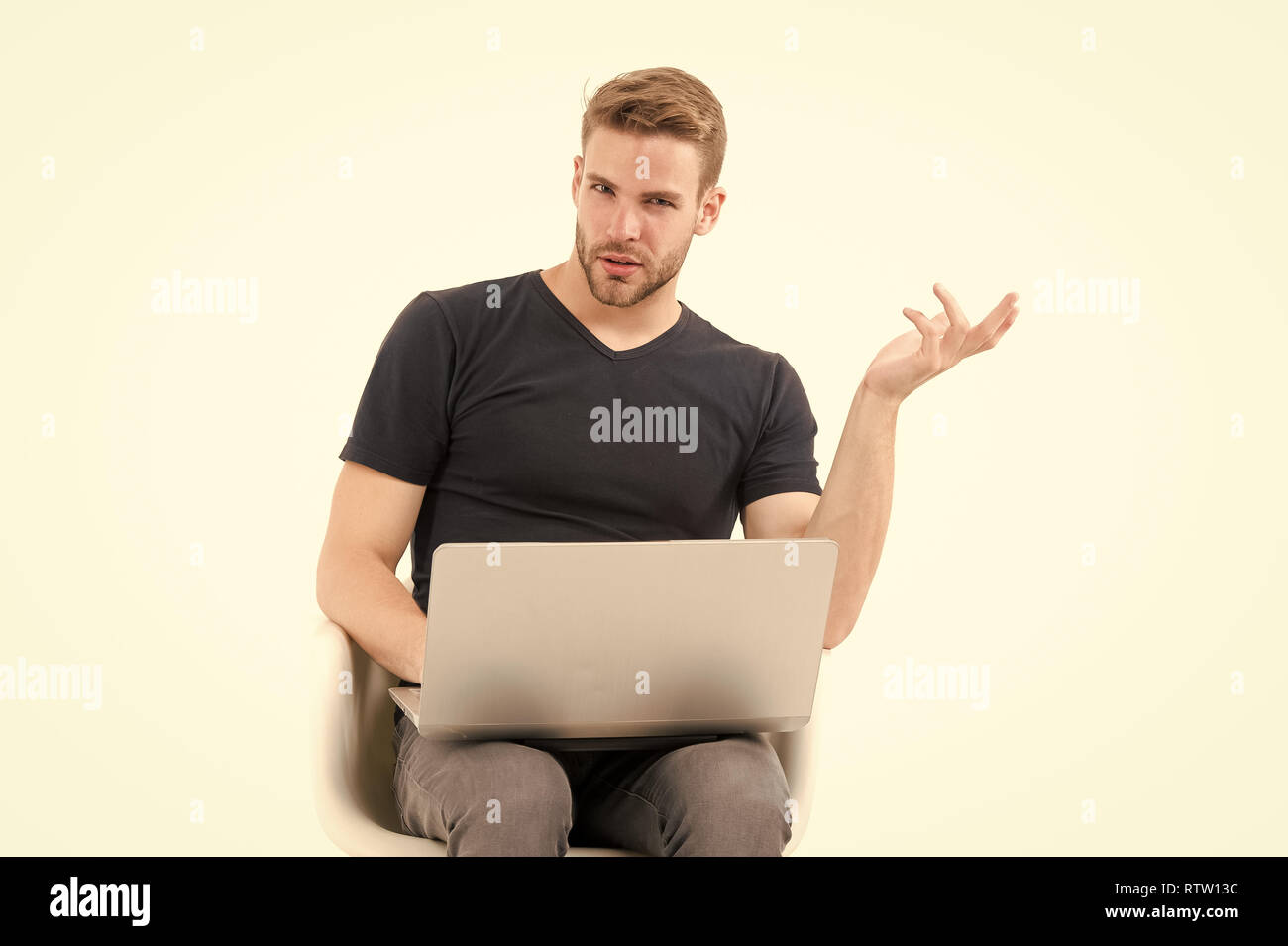Macho use laptop isolated on white. Man with personal computer in casual wear. Agile business and communication. Handsome blogger. Modern life in social network. Internet surfing and virtual world. - Stock Image