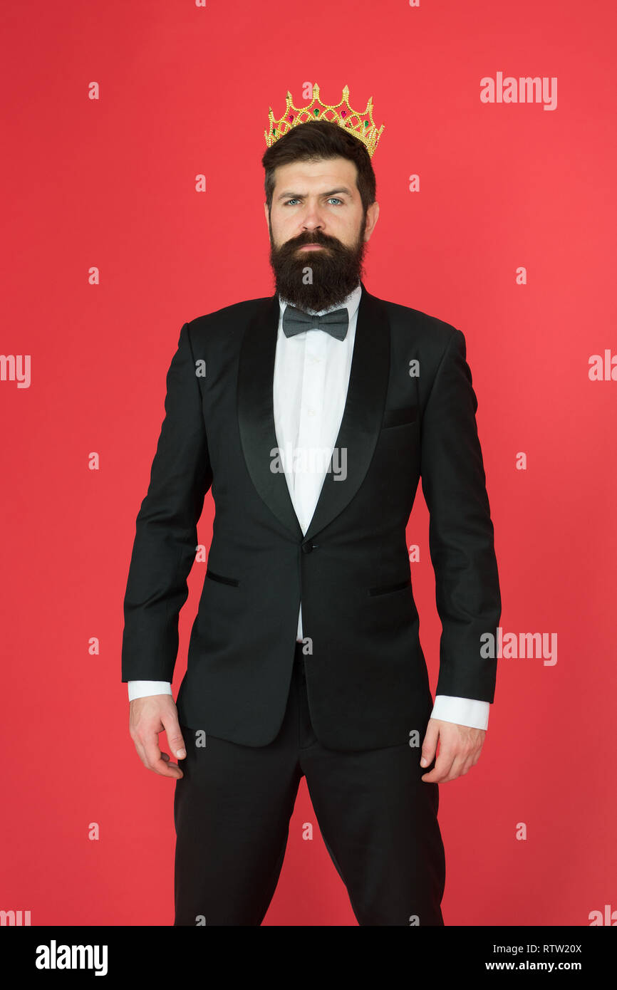 Feeling superior. Man bearded guy in tuxedo golden crown symbol of monarchy. King ceremony. King attribute. Narcissistic king. Self confidence concept. Handsome hipster formal suit. Elite society. - Stock Image