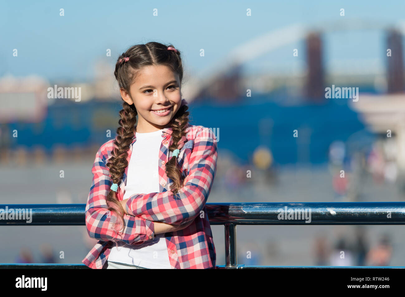 Vacation and leisure. What do on holidays. Sunny day walk. Leisure options. Free time and leisure. Girl cute kid with braids relaxing urban background defocused. Organize activities for teenagers. - Stock Image