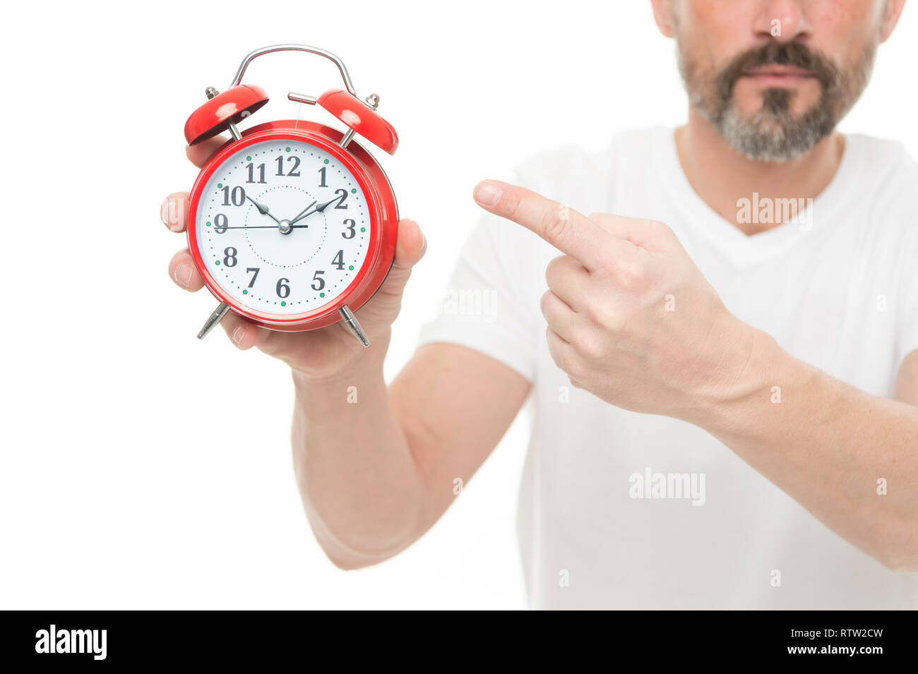 Check time. Man hold alarm clock in hand. Guy bearded mature man worry about time. What time is it. Time management and discipline. Punctuality and responsibility. Man with clock on white background. - Stock Image