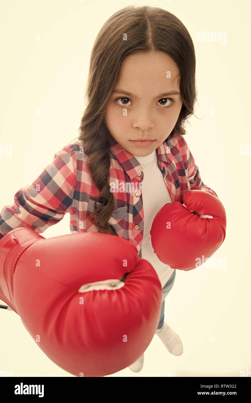 That is what I think. Girls power. Every kid should know how defend own point of view. Girl seriously defending her opinion. Child serious face with gloves practice boxing skills isolated white. - Stock Image