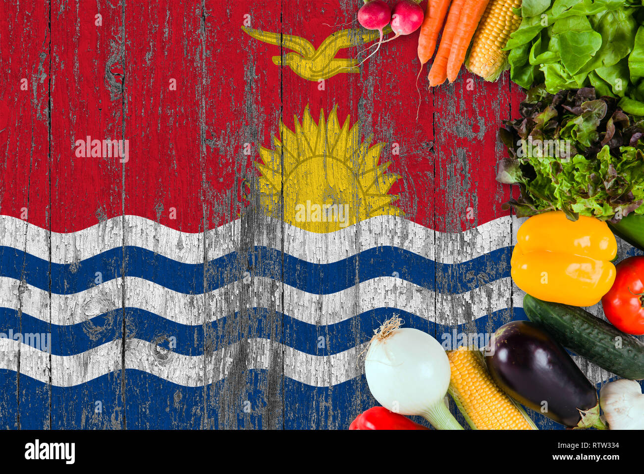 Fresh vegetables from Kiribati on table. Cooking concept on wooden flag background. - Stock Image