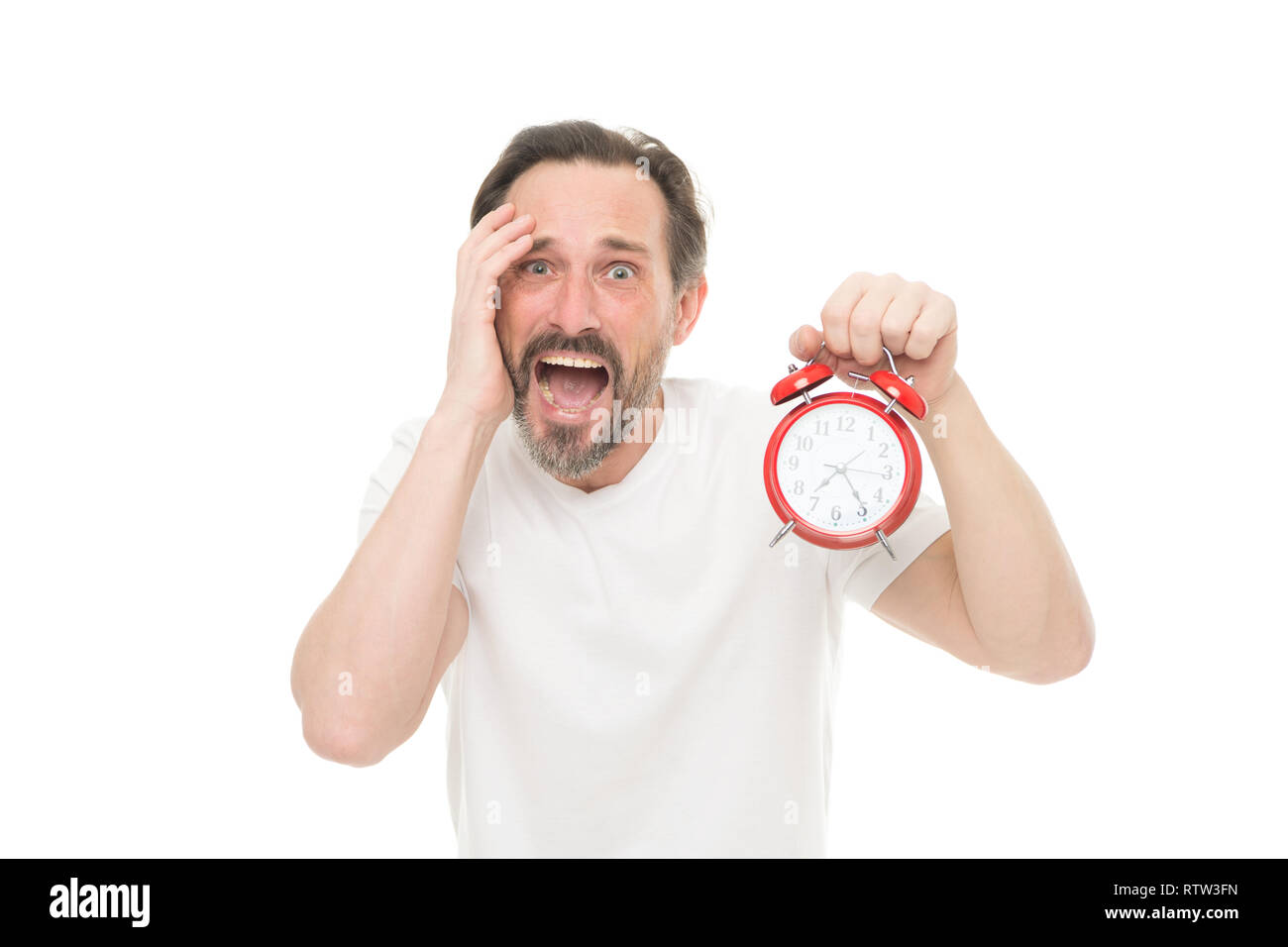 Monday again. Man hold alarm clock in hand. Guy bearded mature man worry about time left till work. Time management and discipline. Punctuality and responsibility. Man with clock on white background. - Stock Image