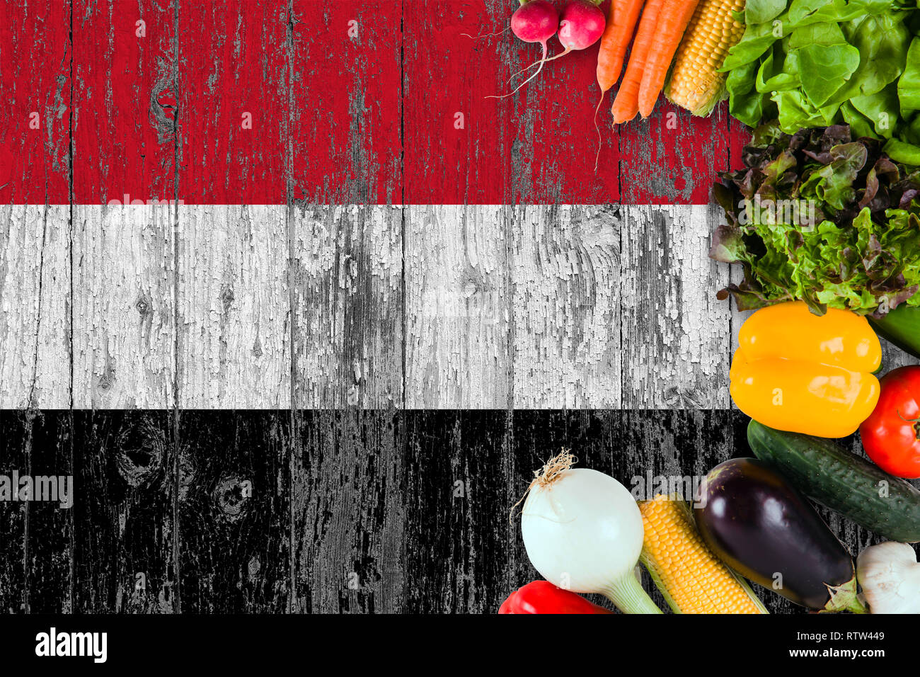 Fresh vegetables from Yemen on table. Cooking concept on wooden flag background. - Stock Image