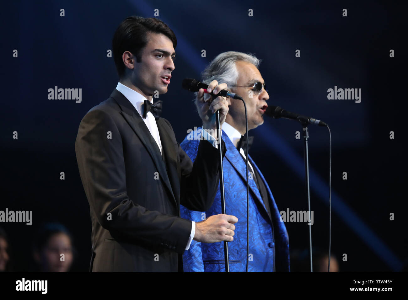 Andrea Bocelli and Matteo Bocelli (left) performing at the naming ceremony of the MSC Bellissima, the largest cruise ship to be christened in the UK, at the City Cruise Terminal in Southampton. - Stock Image