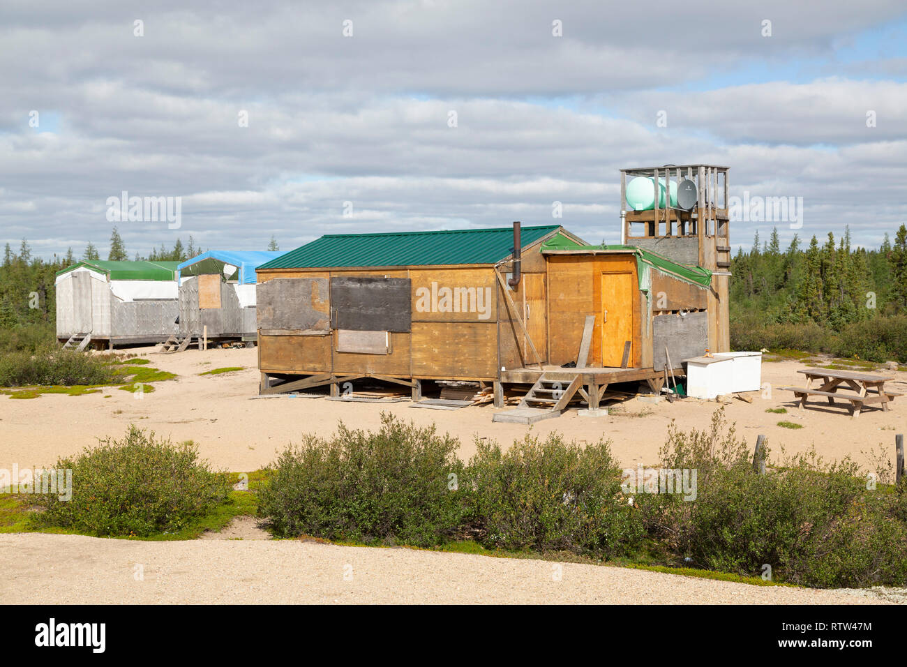 Camp on the border of  Manitoba and Nunavut in Canada. The camp has been used as a base for hunting. - Stock Image