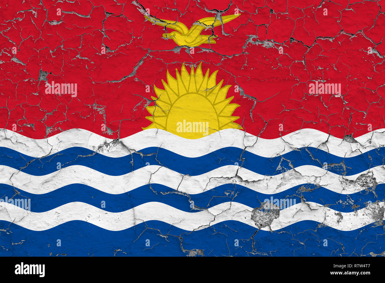 Flag of Kiribati painted on cracked dirty wall. National pattern on vintage style surface. - Stock Image