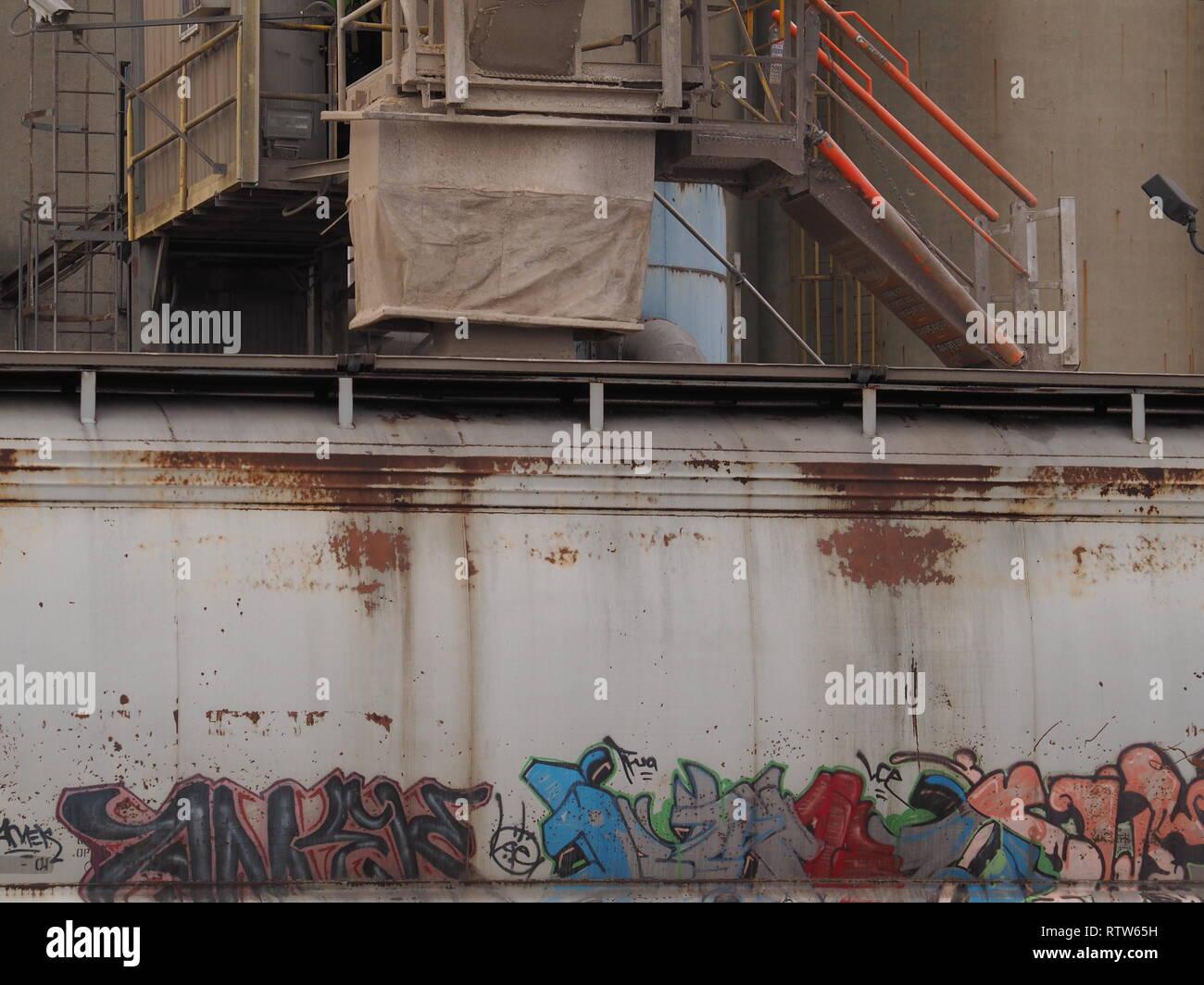 Loading of grain into a graffiti covered railroad car in Circleville Ohio - Stock Image
