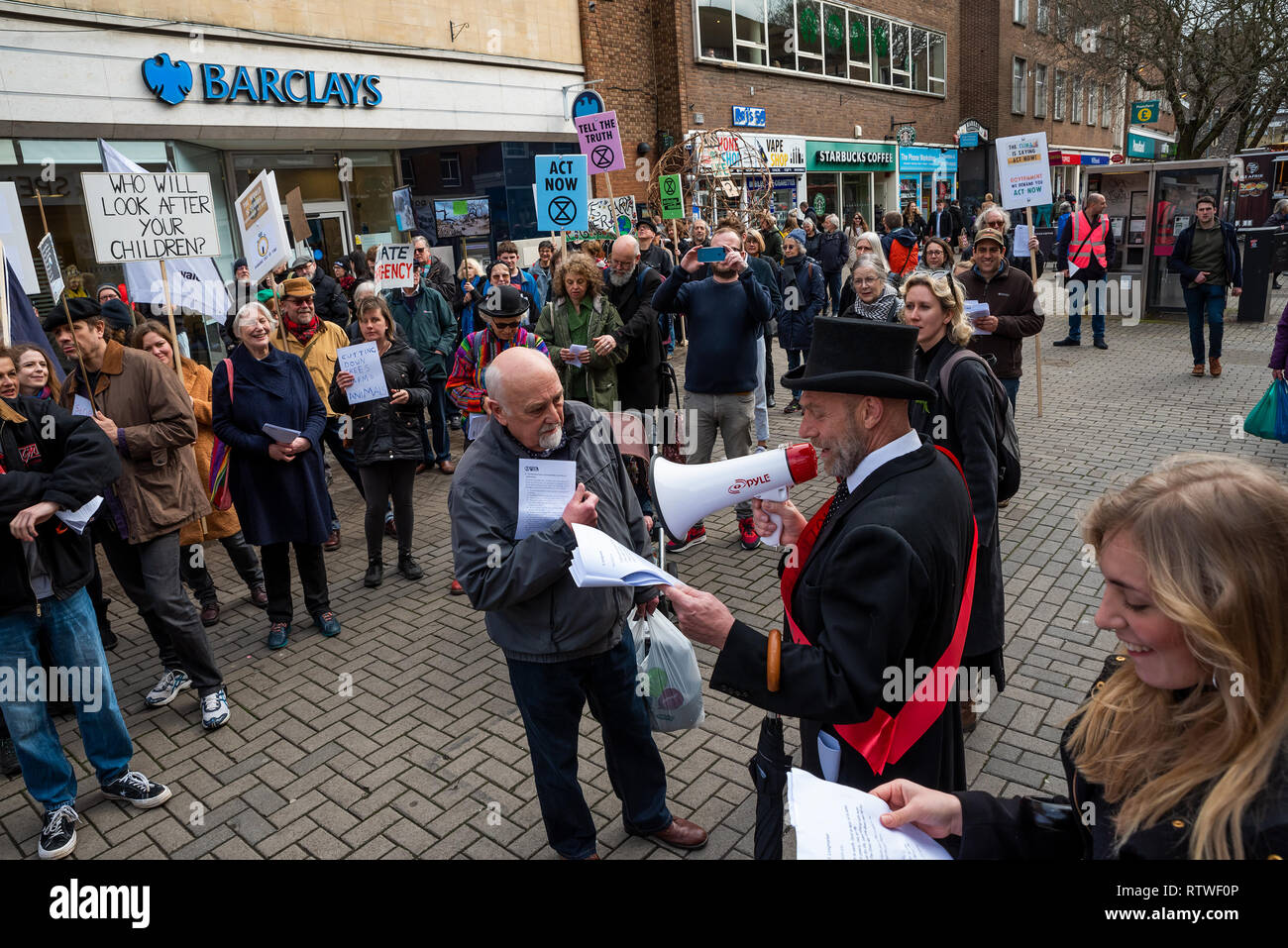 Canterbury, UK. 23rd February 2019. Supporters of the Canterbury Extinction Rebellion Group form up in the City Centre then take part in a symbolic funeral procession representing the death of plants, animals, humans and the planet due to the climate crisis, loss or life. The protest culminated in a swarming action blocking St. Peters Place. Police were present but didn't interfere, there were no arrests. Credit: Stephen Bell/Alamy Live News Stock Photo