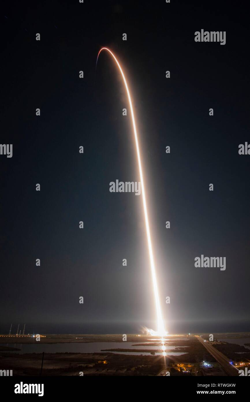 A long exposure of the SpaceX Falcon 9 rocket with the Dragon commercial crew capsule as it streaks across the sky from Launch Pad 39A at the Kennedy Space Center March 2, 2019 in Cape Canaveral, Florida. The test launch of the unmanned spacecraft to the International Space Station is the first commercial crew test and the start of a new era for NASA space travel. - Stock Image