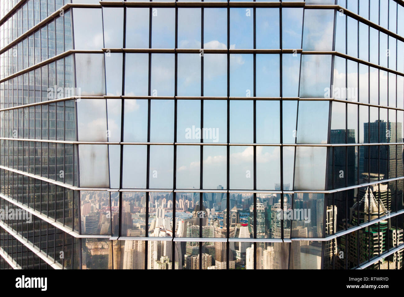 Glass Facade Corner and Reflection Of Skyline of Modern City. Skyline Reflected on Curtain Wall Elevation. Stock Photo