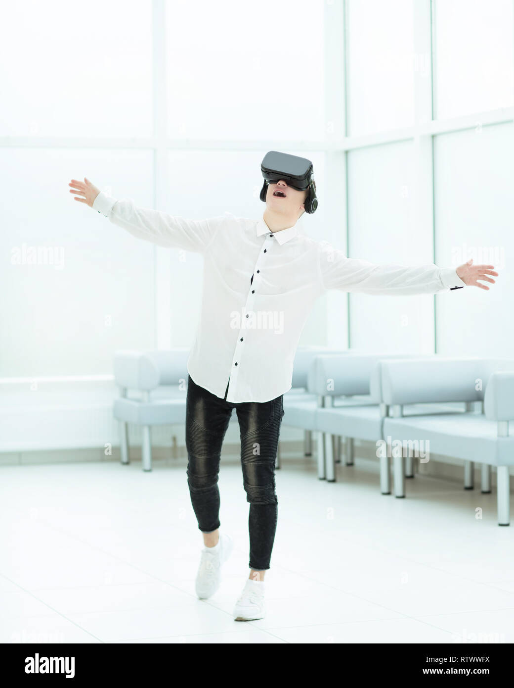 in full growth.a delighted developer is testing virtual reality glasses. - Stock Image