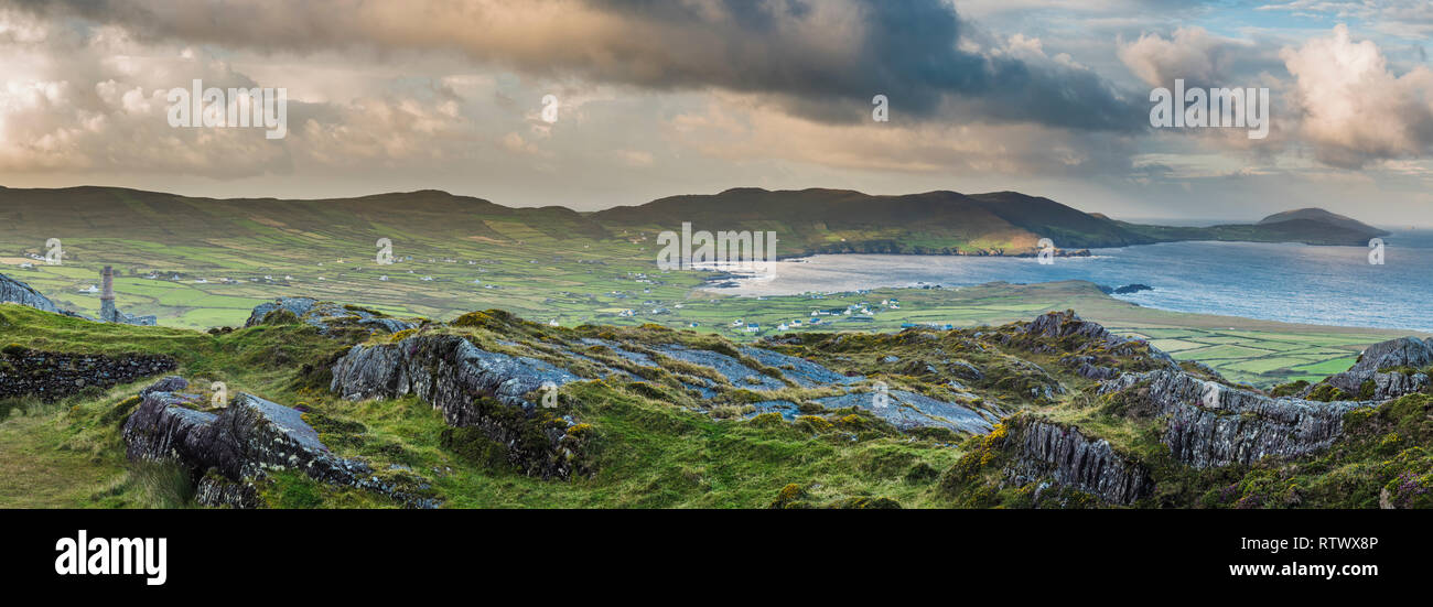 Panoramic view from the Beara Way walking path above the colourful village of Allihies, Beara, County Cork, Ireland - Stock Image
