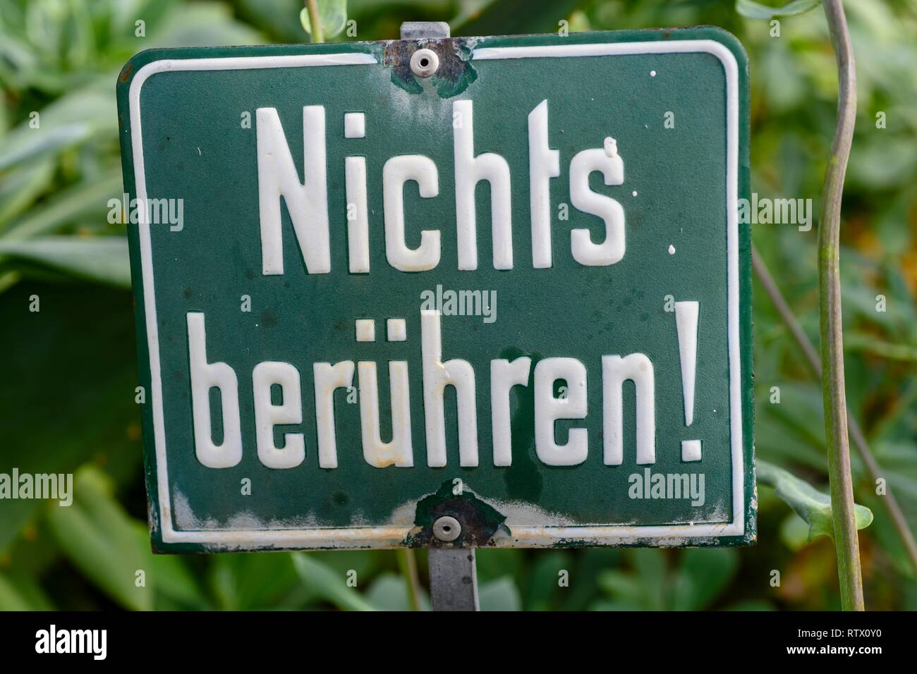 Prohibition sign, Touch nothing, Writing on sign, Germany - Stock Image
