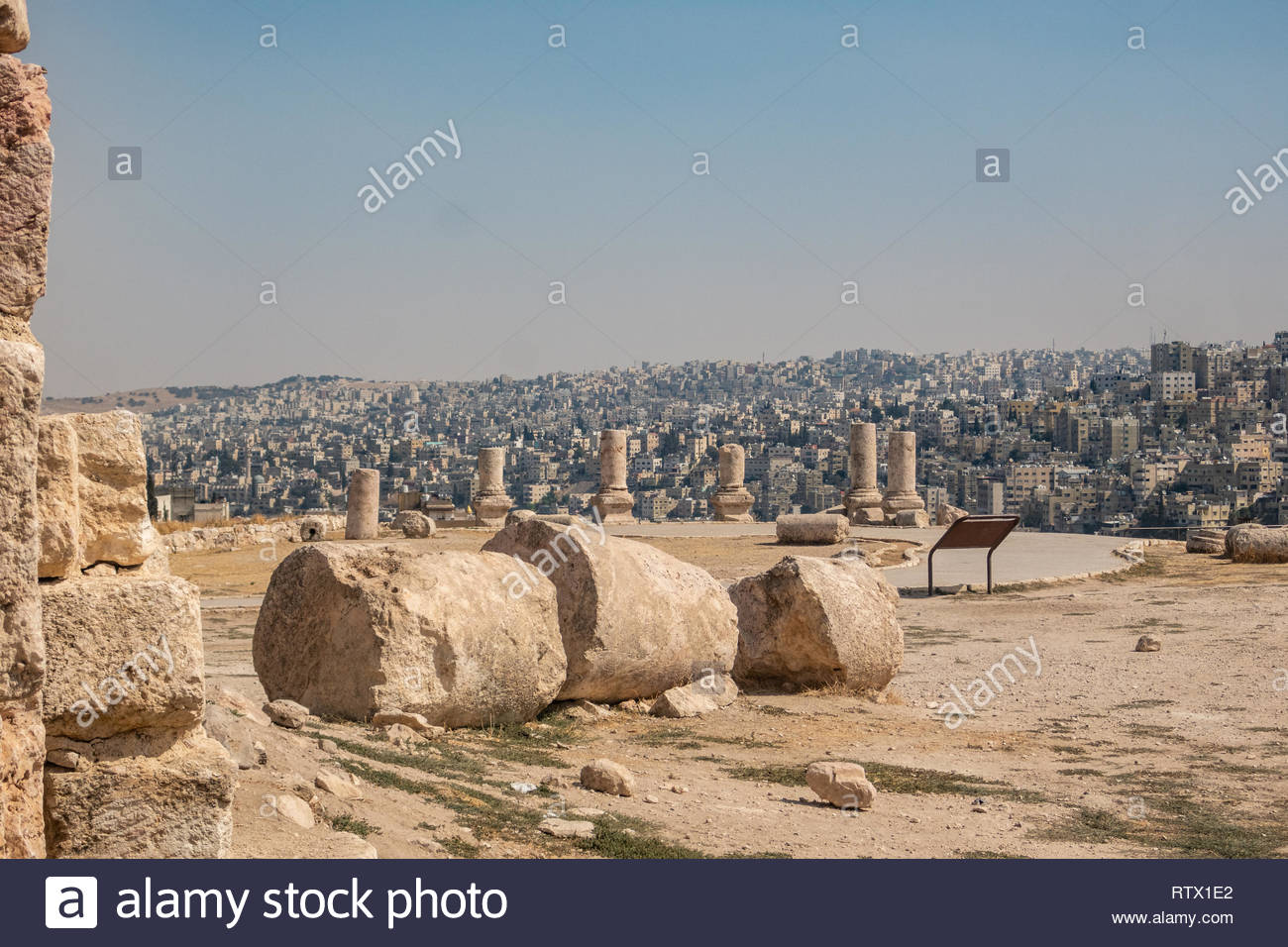 View towards the southern neighbourhoods of Amman, Jordan, from the historic Citadel. Showing remains of Roman architecture. - Stock Image