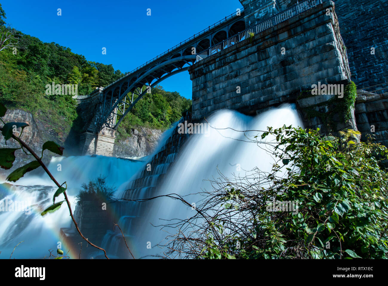 Dam controlling the flow of water. - Stock Image