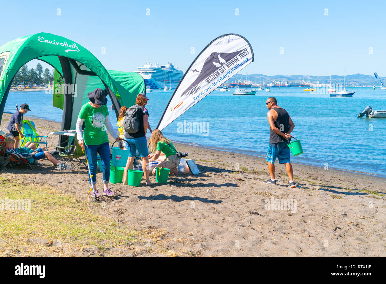 TAURANGA NEW ZEALAND - MARCH 3 2019; Organisation and children, junior environmentalists in Pilot Bay for underwater and beach clean-up. - Stock Image