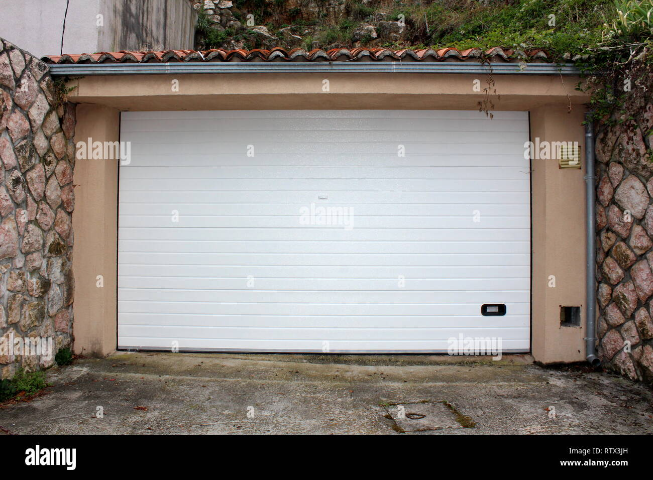 Modern White Rollup Garage Doors With Small Handle For Manual