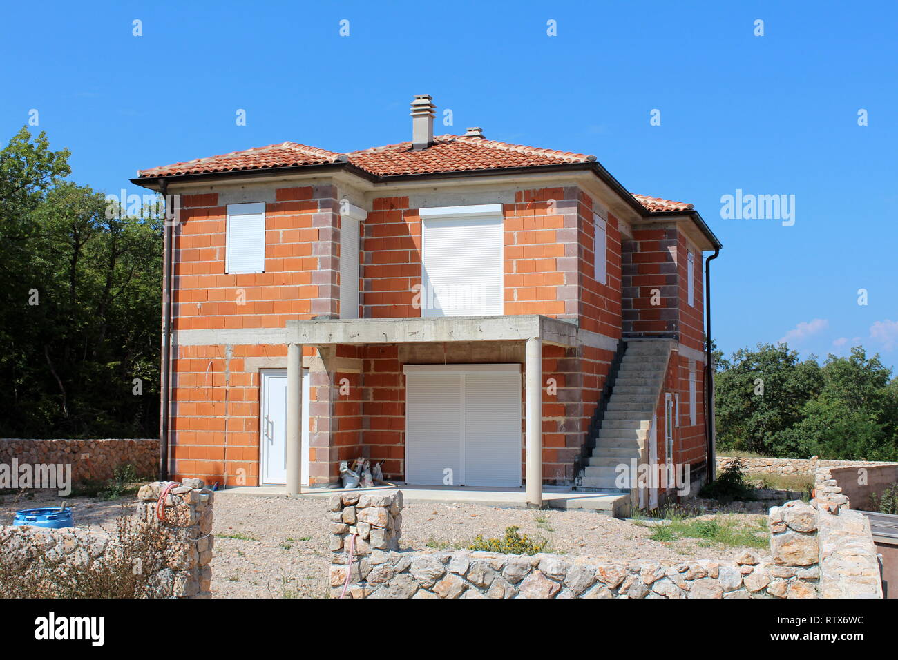 Unfinished Red Bricks Family House With New Doors And