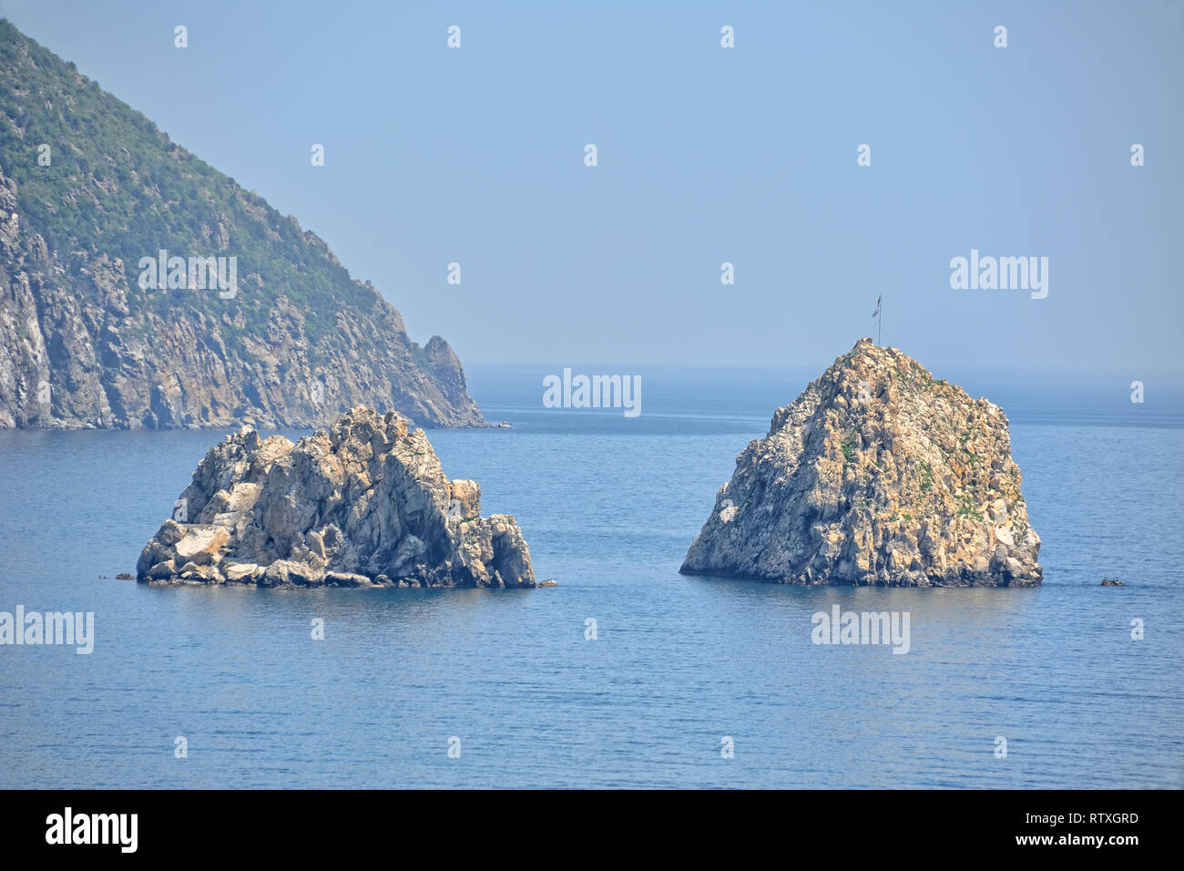 = Adalary Rocks in Gurzuf Bay =  View from a guest house in Gurzuf on the famous rocks Adalary (Two Twin-Cliffs) with an edge of mountain Au-Dag (Bear - Stock Image