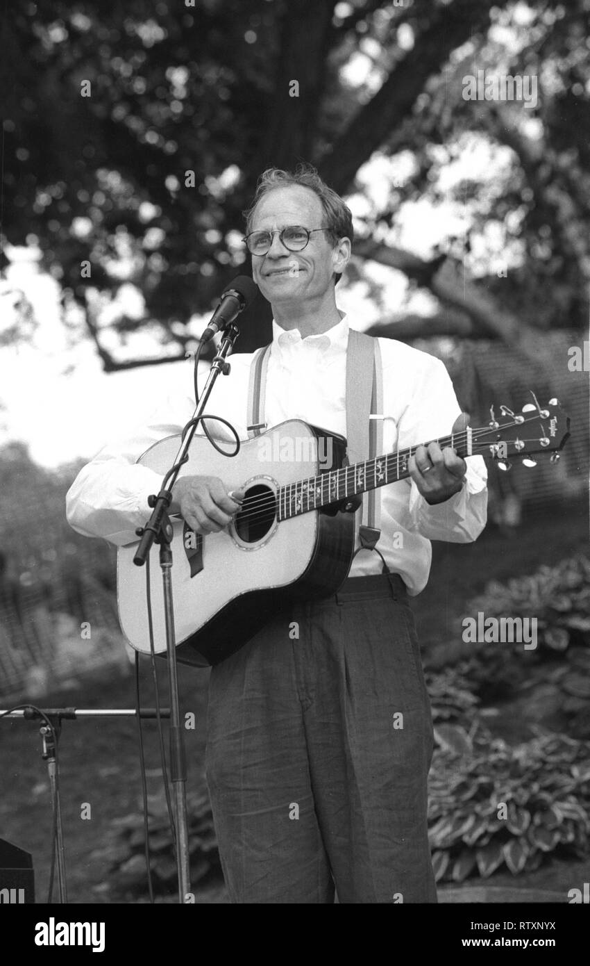 """Singer, songwriter and guitarist Livingston Taylor is shown performing on stage during """"live"""" concert appearance. Stock Photo"""