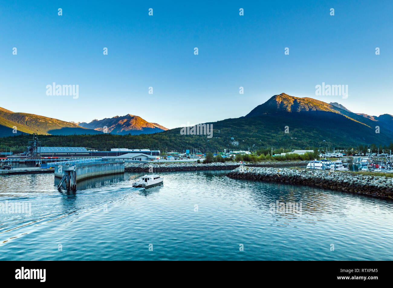 September 15, 2018 - Skagway, Alaska: Fjordlands Express commuter and tourist catamaran ferry enters harbour from Taiya Inlet in the early morning. - Stock Image