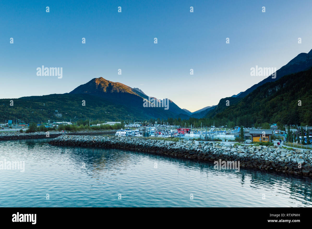 September 15, 2018 - Skagway, AK: Calm early morning of the Small Boat Harbour at daybreak. - Stock Image