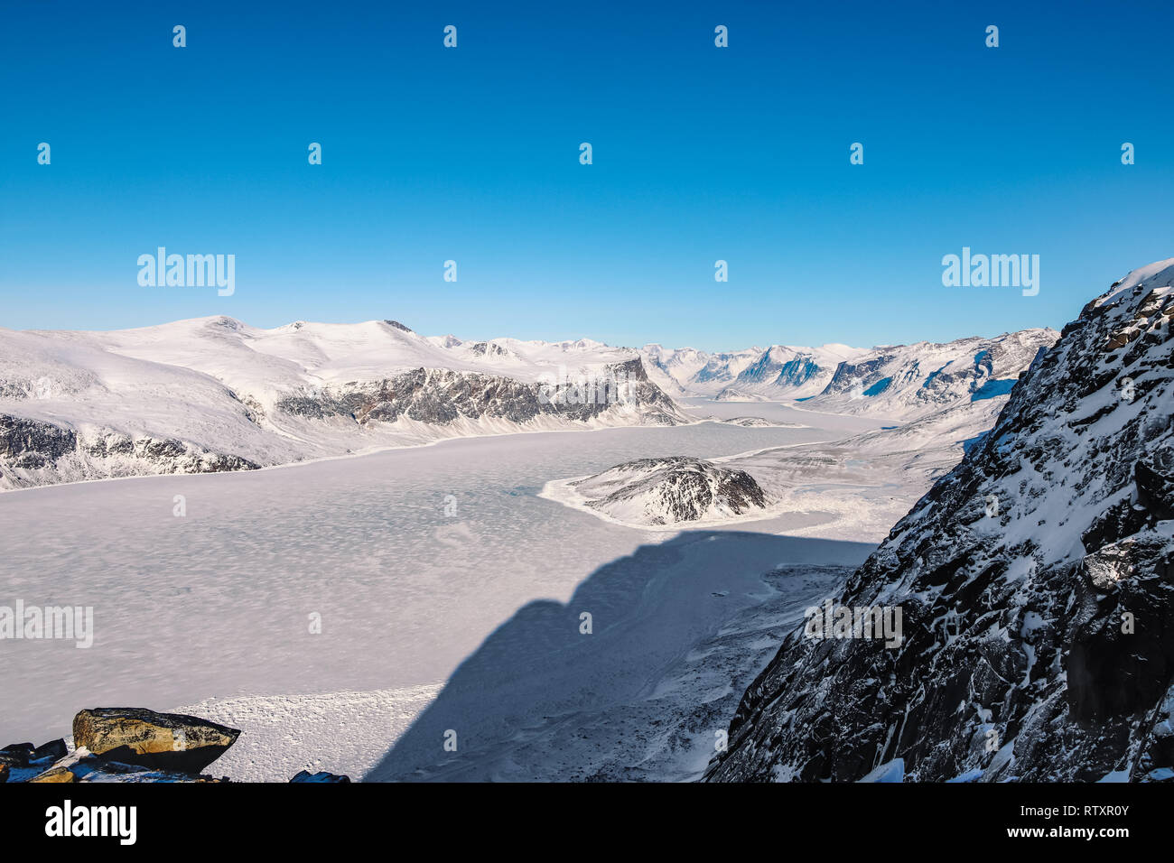 The view from the top of Mount Duval towards Auyuittuq NP - Stock Image