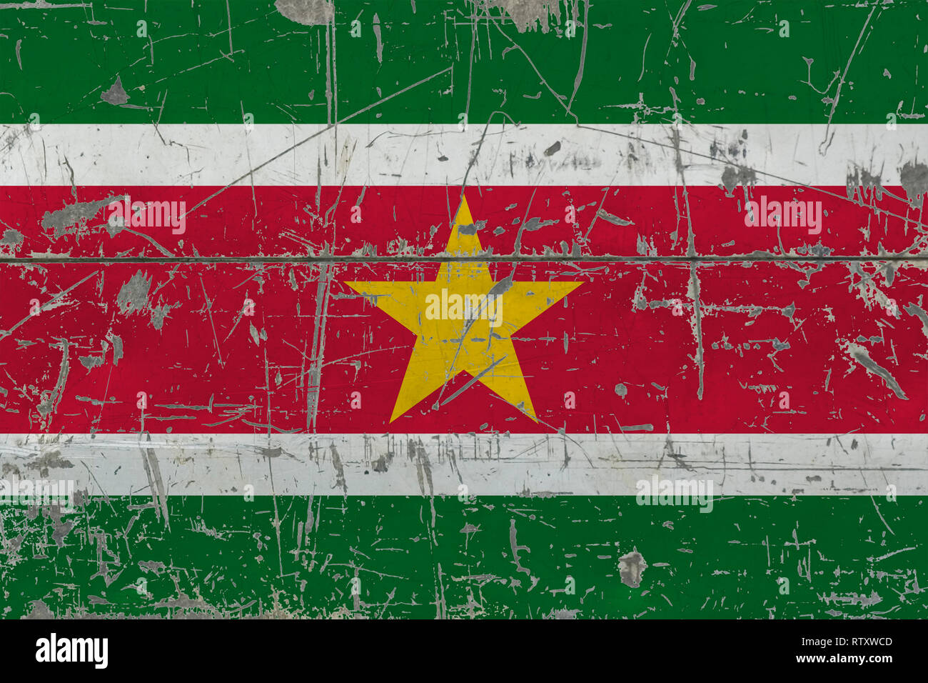 Grunge Suriname flag on old scratched wooden surface. National vintage background. - Stock Image
