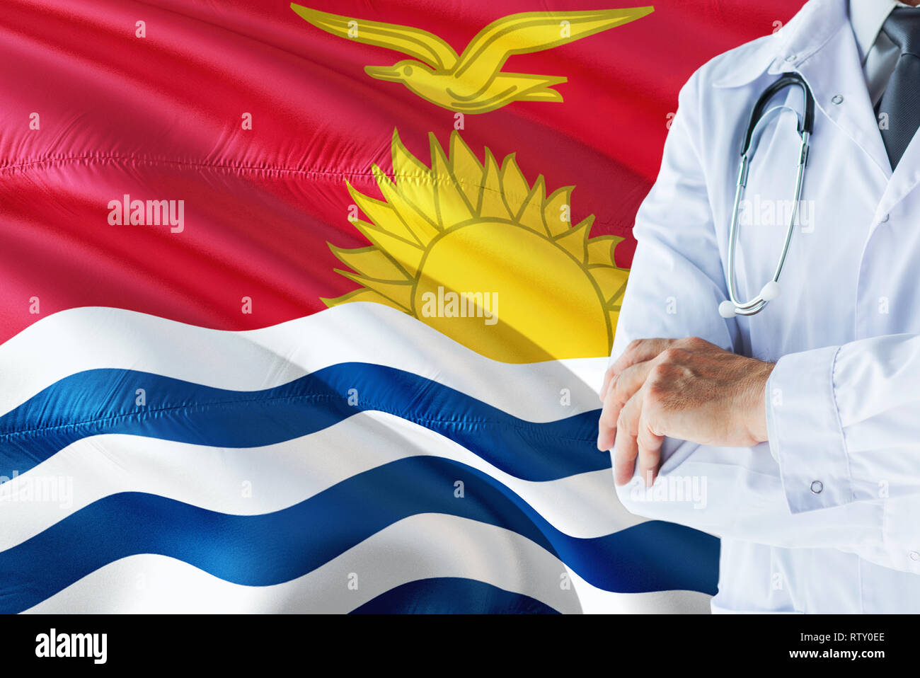 Doctor standing with stethoscope on Kiribati flag background. National healthcare system concept, medical theme. - Stock Image