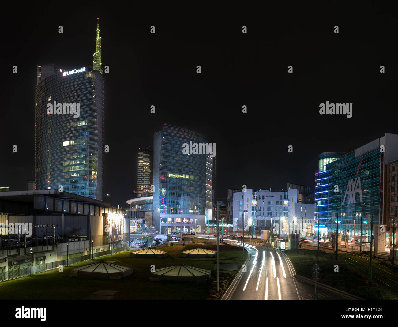 03/02/2019 Mialn, Italy: Unicredit tower, Gae Aulenti square, financial district of milan seen from the overpass Bussa. Nocturnal scene with light tra Stock Photo