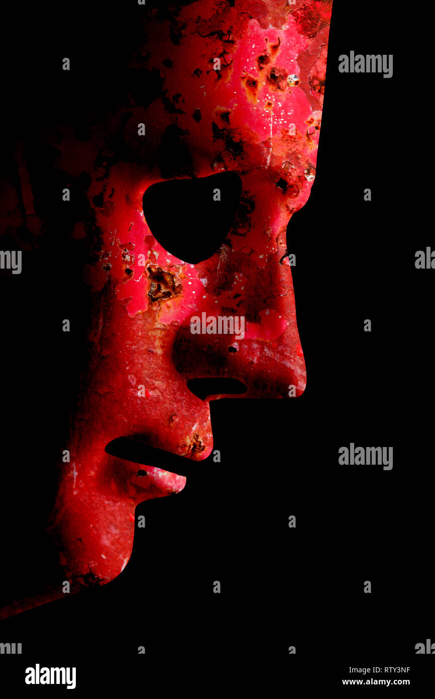 Robot rusty decaying red face mask side view close up with textured skin and blank eyes. Black background and space for text. Artificial intelligence  - Stock Image