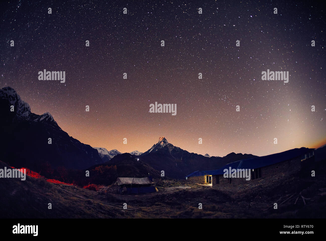 Machapuchare Mountain of Himalayas at night starry sky in Nepal - Stock Image