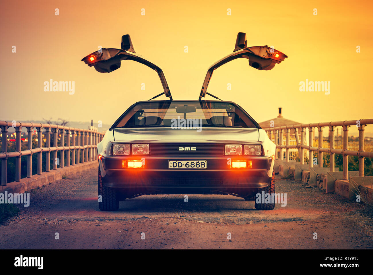 Adelaide, Australia - September 7, 2013: DeLorean DMC-12 car with opened gullwing doors parked on the bridge at dusk - Stock Image