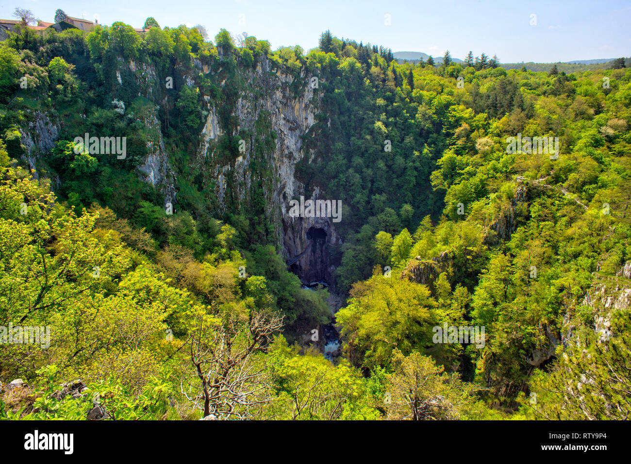 Unesco World Heritage Site Skocjanske Jame Looking Towards The Deep Gorge With Cave Entrance And Walking Paths Village Of Skocjan In The Background Stock Photo Alamy