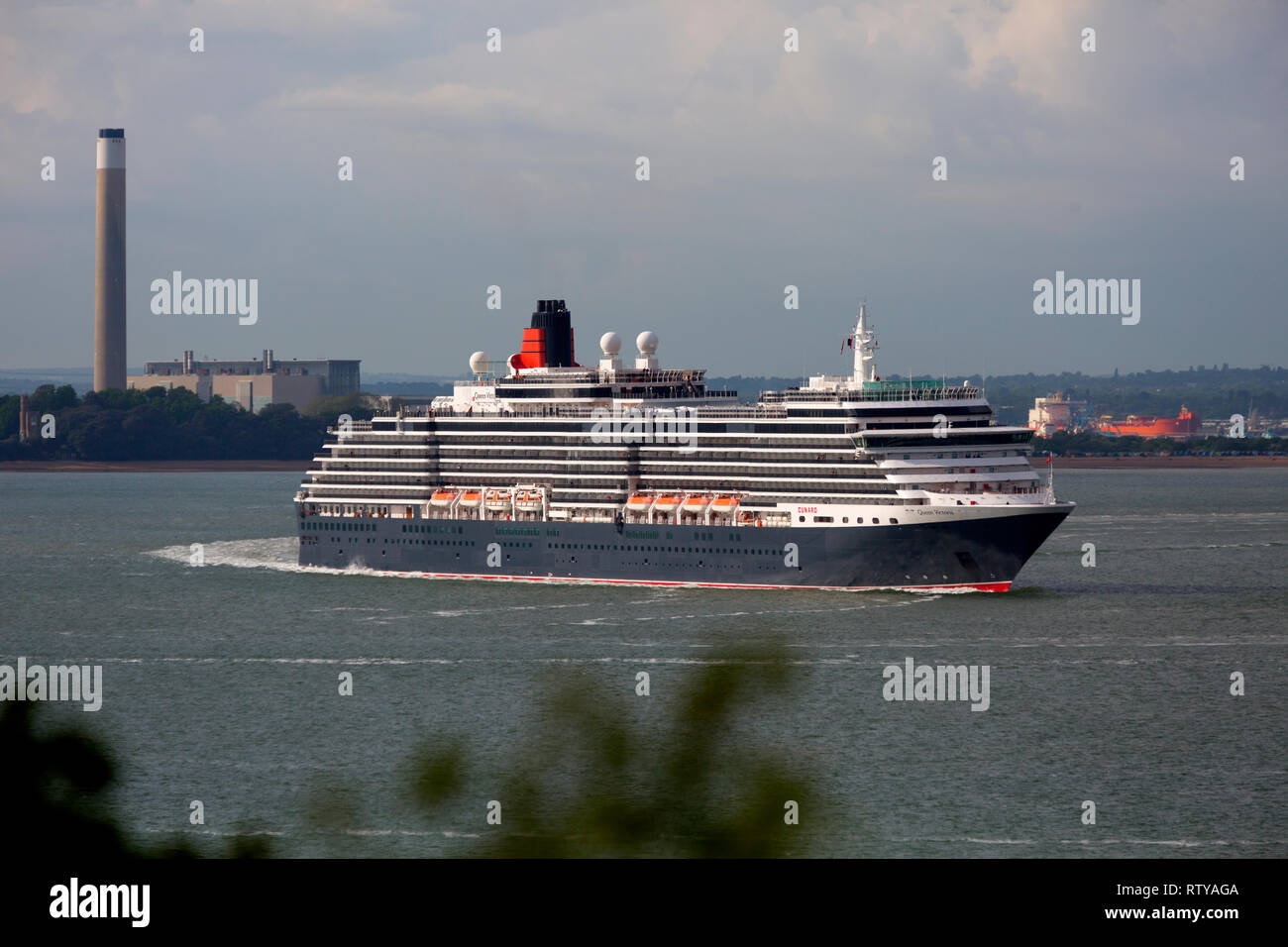 Luxury, travel, luxurious, wedding, honeymoon, suite, cabin, Queen Victoria cruise liner leaving Southampton,Pollution,Cowes Isle of Wight England UK Stock Photo