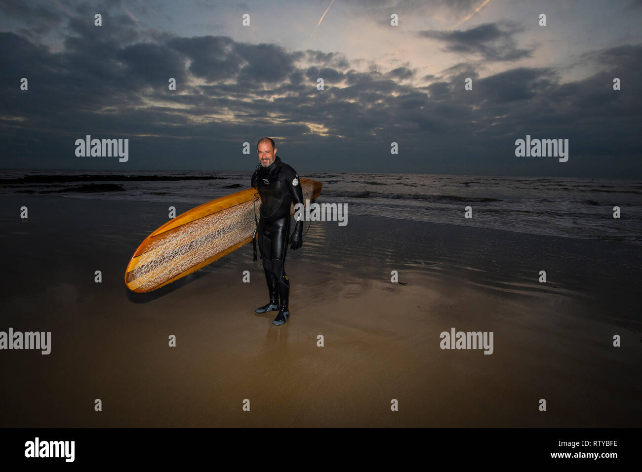 Surfer, Fill in Flash, Dusk, Compton Beach, Isle of Wight, England, UK, - Stock Image