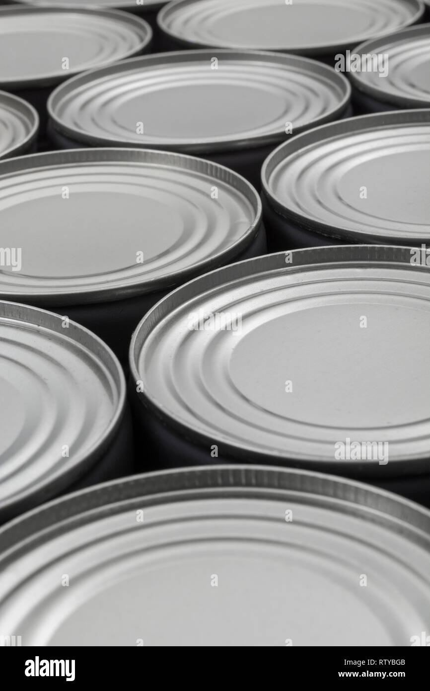 Mass of light steel food cans / tinned food. Metaphor food preservation, catering industry, food manufacturing, food supply, Brexit stocking up - Stock Image